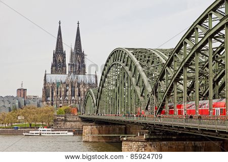 Cologne Cathedral And Hohenzollern Bridge Over Rhine River