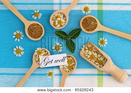 Get well card with dried chamomile herbs on wooden spoons
