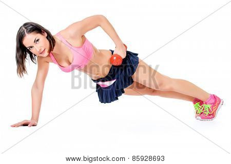Slender young woman with beautiful athletic body pushed from the floor with the dumbbell. Fitness, bodybuilding. Health care. Isolated over white.