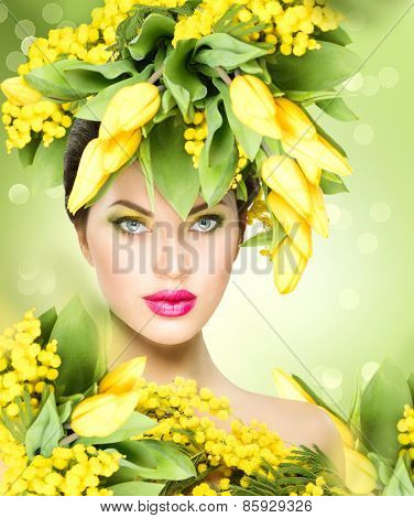 Spring woman. Beauty Spring model Girl with Flowers Hair Style. Beautiful lady with Blooming flowers on her head. Nature Hairstyle. Holiday Creative Fashion Makeup. Make up. Vogue Style Portrait
