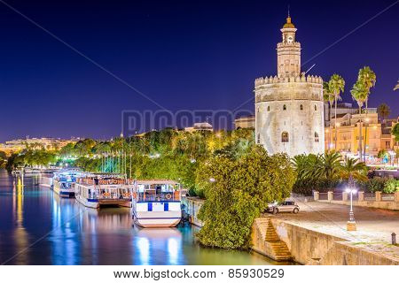 Seville, Spain at the Torro de Oro on the Guadalquivir River.