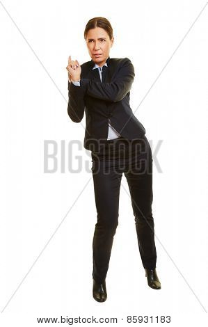 Isolated full body businesswoman leaning and pushing on imaginary wall