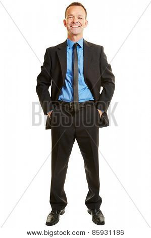 Full body portrait of a happy businessman isolated with hands in his pockets
