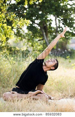 Young man practicing yoga and meditating