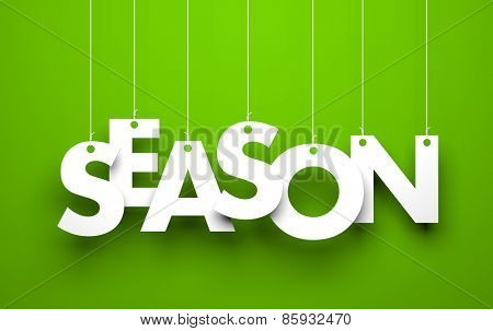 White word SEASON suspended by ropes on green background