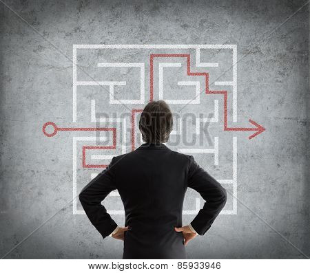 businessman solves complicated maze