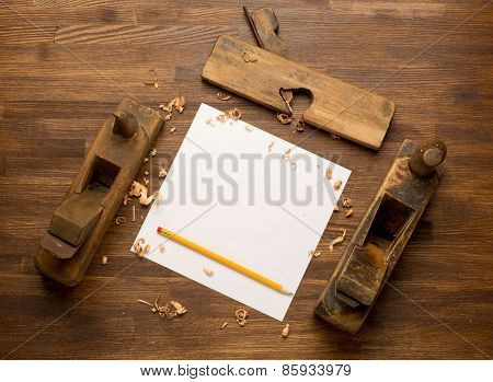 Old wooden jointers,jack-plane on the wood table with grunge texture and paper