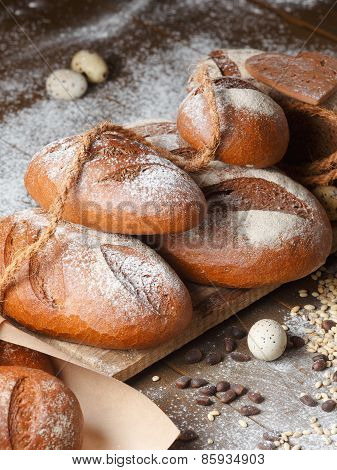 Variety of rye bread on a wooden background