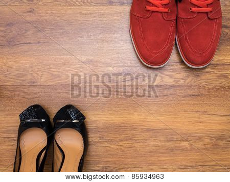 Red sneakers and black women's shoes