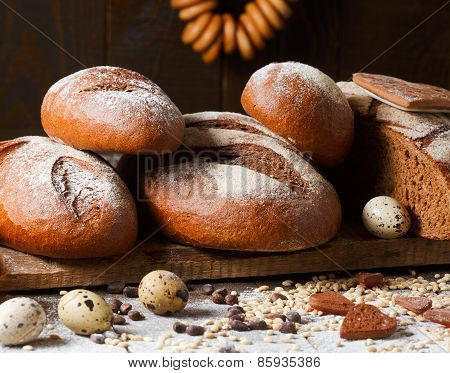 Variety of rye bread on a wooden background with milk