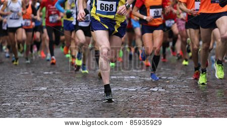 Runners During Marathon While It Is Raining