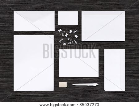 Top View Of Branding Identity Mockup And Template On Black Table Surface