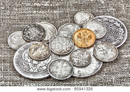 old coins on sacking