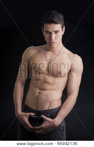 Handsome, Fit Shirtless Young Man Wearing Only Pants