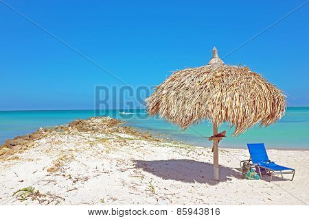 Grass umbrella at the beach on Aruba in the Caribbean