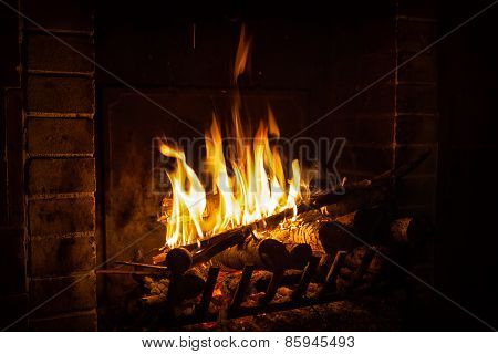 Bright Flame Of Fire Burns In A Fireplace
