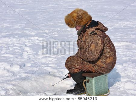 Fisherman On Ice Fishing