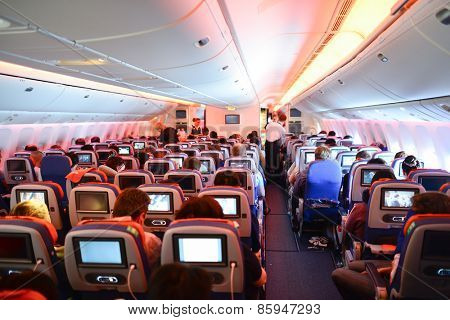MOSCOW, RUSSIA - APRIL 21, 2014: Aeroflot Boeing-777 interior. OJSC Aeroflot â?? Russian Airlines is the flag carrier and largest airline of the Russian Federation