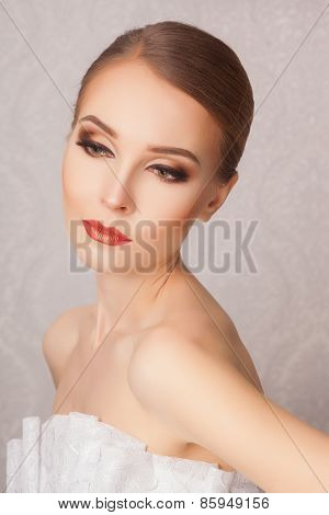 beautiful and fashion bride with glamour makeup and hairstyle in luxury interior