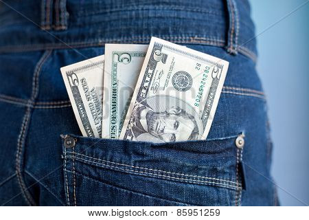 Five Dollars Banknotes In A Pocket Of Jeans
