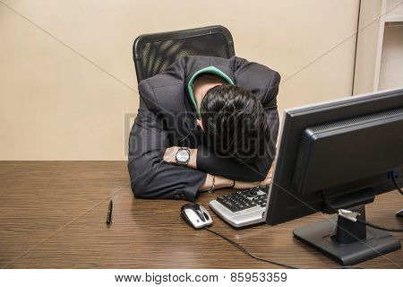 Overworked, Tired Young Businessman Sleeping In Office