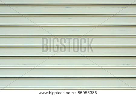 Rolled Shutter Door. Beige Color.