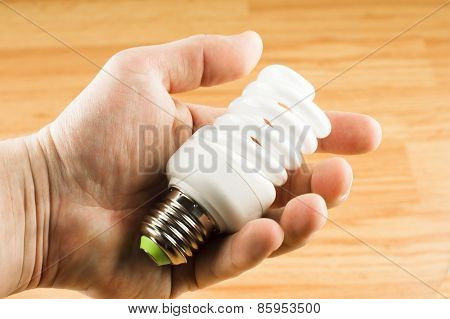 Luminescent Light Bulb In His Hand