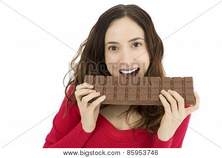 Woman Biting A Big Chocolate Bar