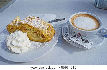 Cappuccino and apple strudel