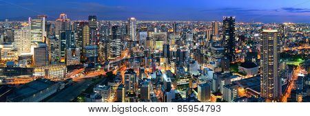 Osaka urban city at night panorama rooftop view. Japan.