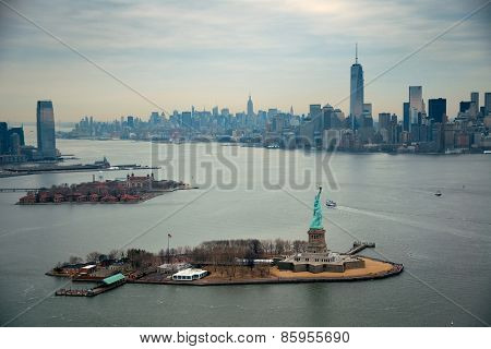 New York City Manhattan aerial view with downtown skyscrapers and statue of liberty