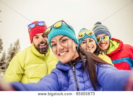 Snowboarders Taking Selfie