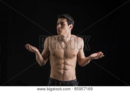 Charismatic Muscular Man Shrugging His Shoulders