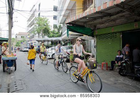 Traveller cycling tour at Tarad Noi traditional neighborhood Bangkok,Thailand.