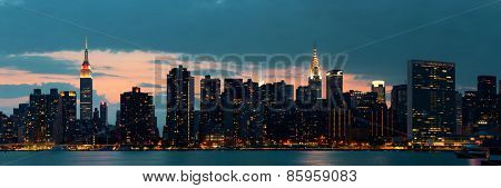 Midtown Manhattan skyline at dusk panorama over East River