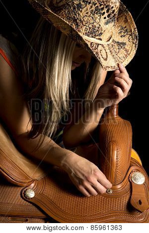 Cowgirl Lean On Saddle Hat On Look Down Dark