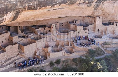 Tourist Groups Taking A Tour In Mesa Verde