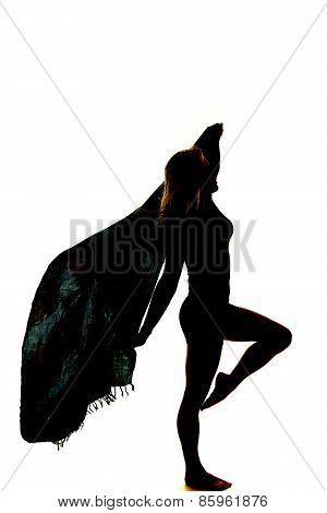 Silhouette Of A Woman With A Sarong Blowing Foot Up By Knee
