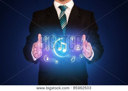 Businessman holding digital multimedia icons