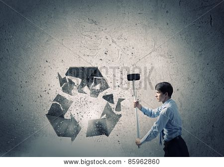 Young businessman in anger crashing stone recycle symbol