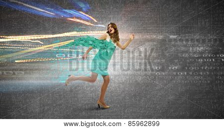 Businesswoman with briefcase jumping against digital background