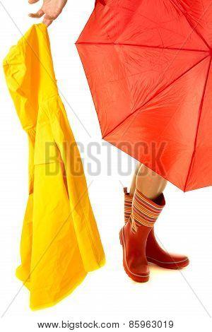 Woman Legs Under Umbrella Holding Out Rain Coat