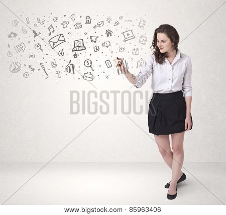 Young woman drawing and sketching icons and symbols on white background