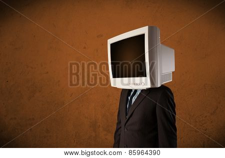Business man with a monitor on his head concept and brown empty space