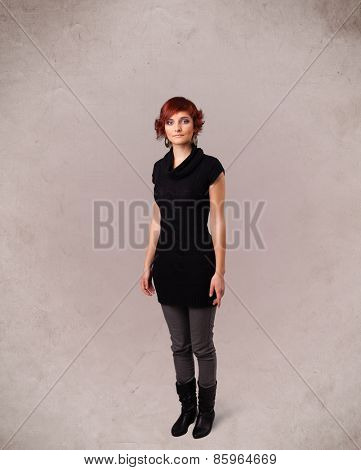 Portrait of a young cute girl with empty copy space on grungy background