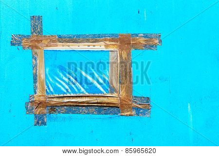 Vintage Blue Wall With Cracks, Scratches, Frame Is Made From Strips Of Old Adhesive Tape. Textured B