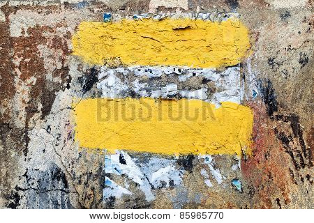 Abstract Cvintage Old Damaged Wall With Cracks, Scratches And Scraps Of Paper, Painted With Yellow P