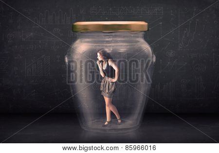 Businesswoman shut inside a glass jar concept concept on background