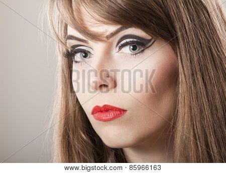 Portrait of young woman looking in camera