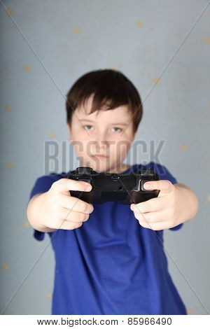 Boy With A Joystick Playing Computer Game